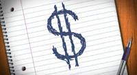Dollar sign on notebook paper