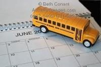 toy school bus sitting on a calendar